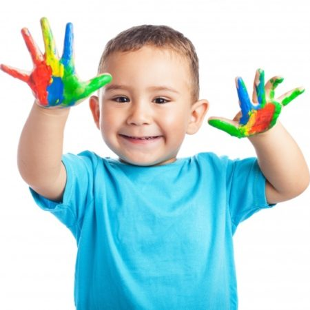 child-smiling-with-hands-full-paint_1187-2855