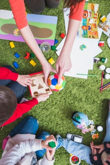 teacher-playing-with-kids_23-2147797852